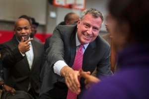 Democratic New York City mayoral candidate Bill de Blasio greets supporters at a campaign stop in New York